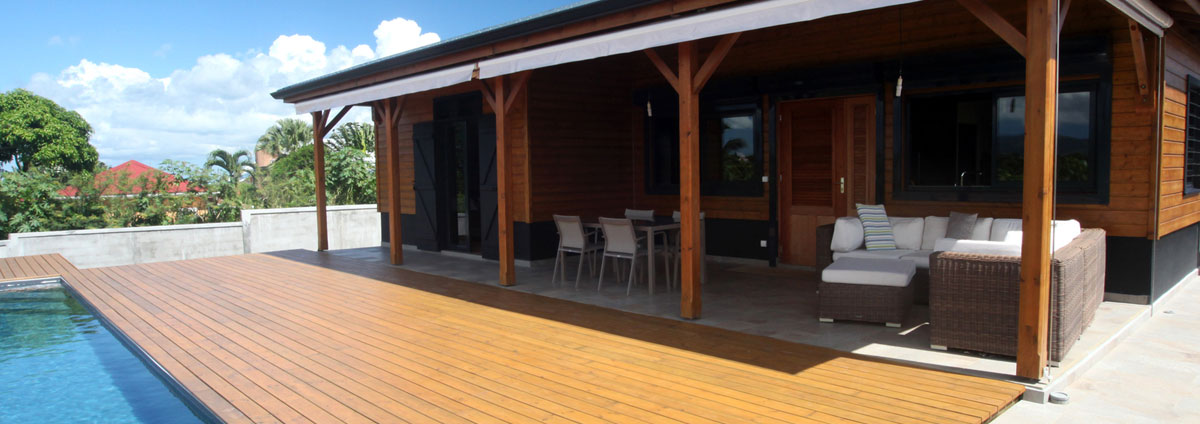 Maison bois guadeloupe stunning jardin et terrasse for Maison modulaire guadeloupe